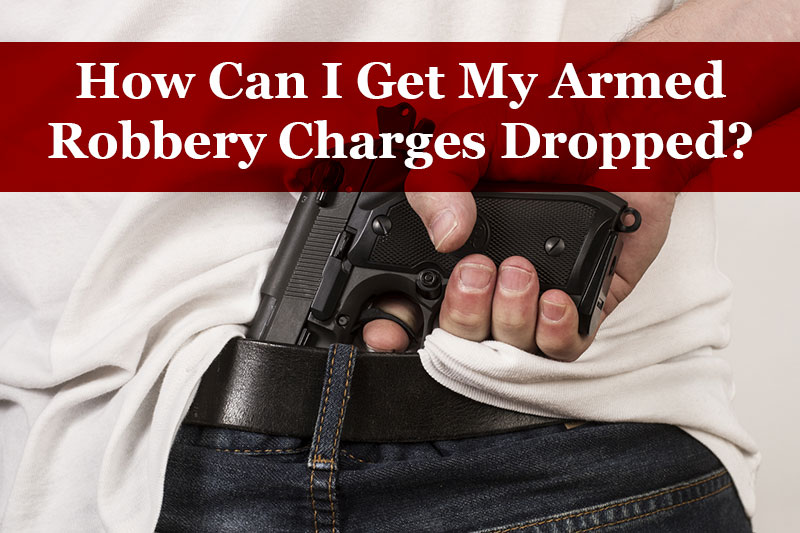 get armed robbery charges dropped